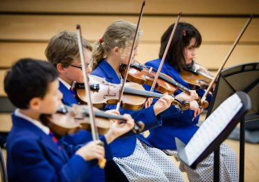 Image of Fairfield children playing Violin