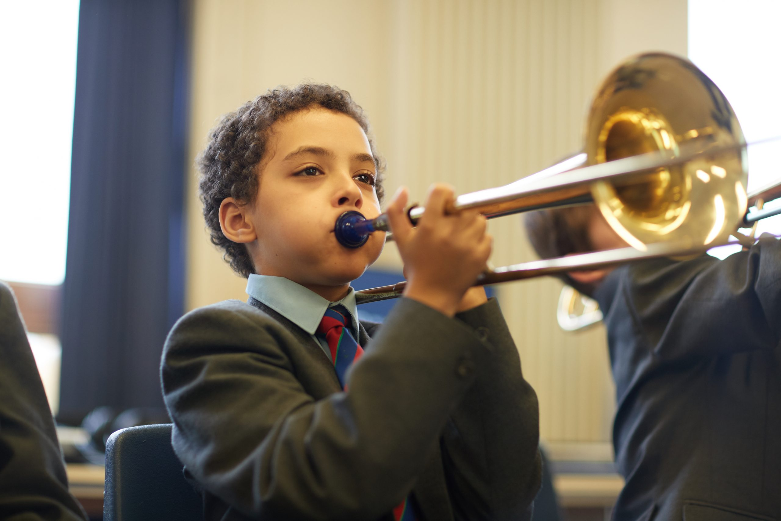 Year 6 pupil playing trombone
